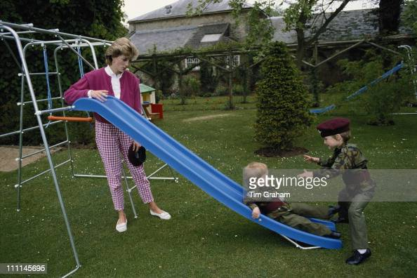 Princes William and Harry wearing the uniform of the Parachute Regiment of the British Army in the garden of Highgrove House in Gloucestershire 18th...
