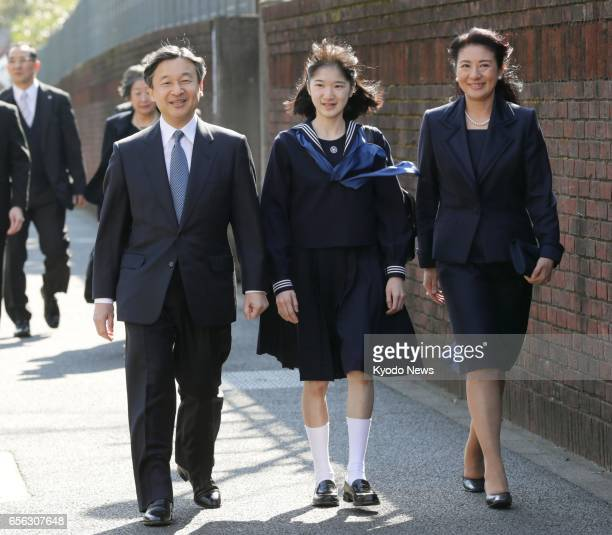 Princess Aiko accompanied by her parents Crown Prince Naruhito and Crown Princess Masako heads for her graduation ceremony at Gakushuin Girls' Junior...