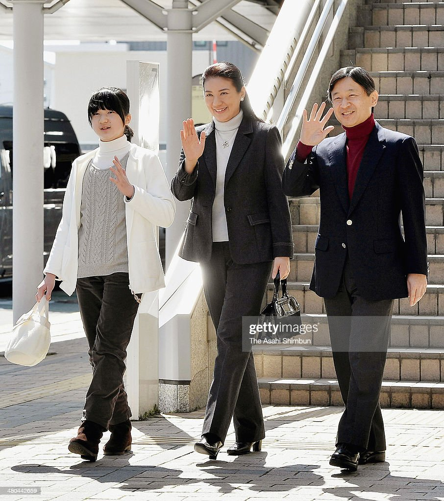 Princess Aiko, Crown Princess Masako and Crown Prince Naruhito wave to well-wishers upon arrival at Nagano Station on March 24, 2014 in Nagano, Japan. They will spend a couple days at a ski resort.