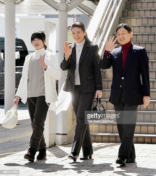 Princess Aiko Crown Princess Masako and Crown Prince Naruhito wave to wellwishers upon arrival at Nagano Station on March 24 2014 in Nagano Japan...