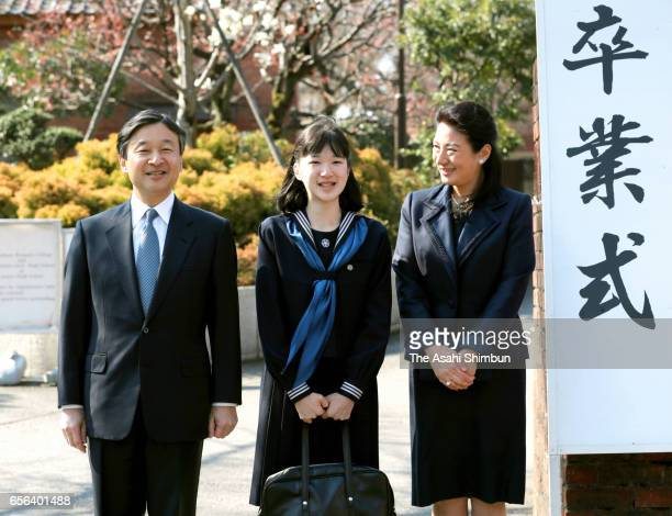Princess Aiko poses for photographs along with her parents Crown Prince Naruhito and Crown Princess Masako prior to attend her graduation ceremony at...