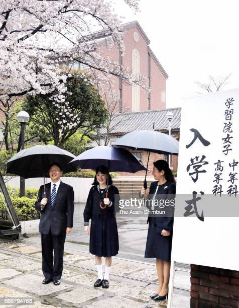 Princess Aiko poses for photographs with her parents Crown Prince Naruhito and Crown Princess Masako ahead of the entrance ceremony at the Gakushuin...
