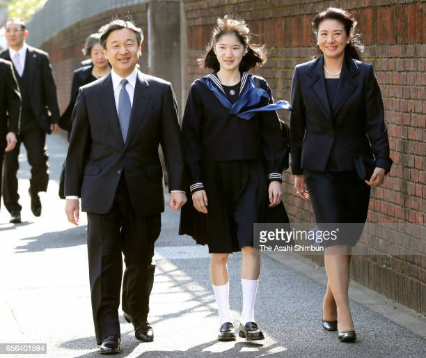 Princess Aiko walks along with her parents Crown Prince Naruhito and Crown Princess Masako prior to attend her graduation ceremony at Gakushuin...