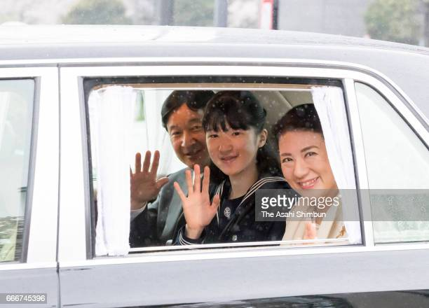 Princess Aiko waves to reporters with Crown Prince Naruhito and Crown Princess Masako on arrival at the Imperial Palace to meet Emperor Akihito and...
