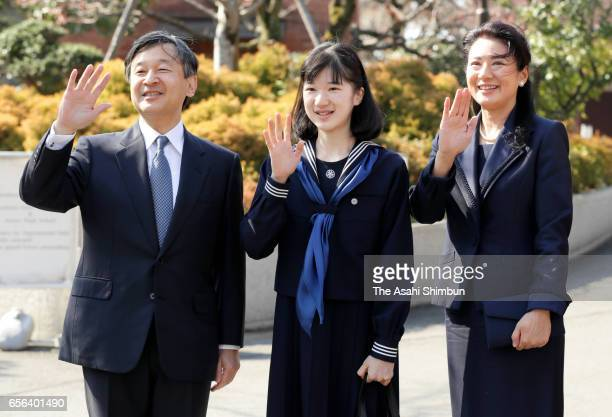 Princess Aiko waves to wellwishers along with her parents Crown Prince Naruhito and Crown Princess Masako prior to attend her graduation ceremony at...