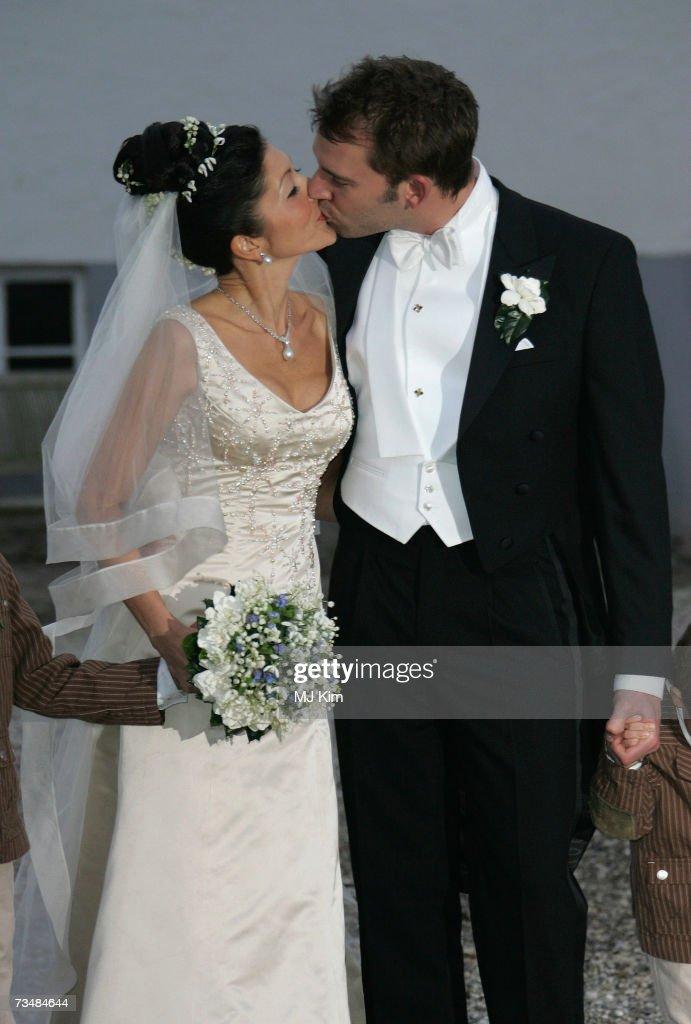 Princess Alexandra Christina of Denmark kisses her husband Martin Jorgensen after their wedding ceremony at Oster Egende Church on September 18, 2006 in Fakse, Denmark.