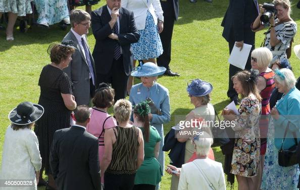 Princess Alexandra meets guests at a garden party in honour of the society at Buckingham Palace on June 12 2014 in London England