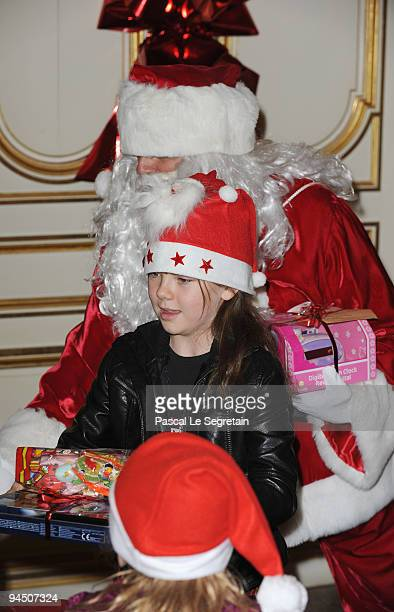Princess Alexandra of Hanover is seen with Santa Claus as she distributes presents to Monegasque children during Christmas Tree party at Monaco...