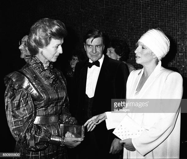 Princess Alexandria talks to American actress Barbra Streisand when they attend the royal charity premiere of 'Yentl' of which Streisand is producer...