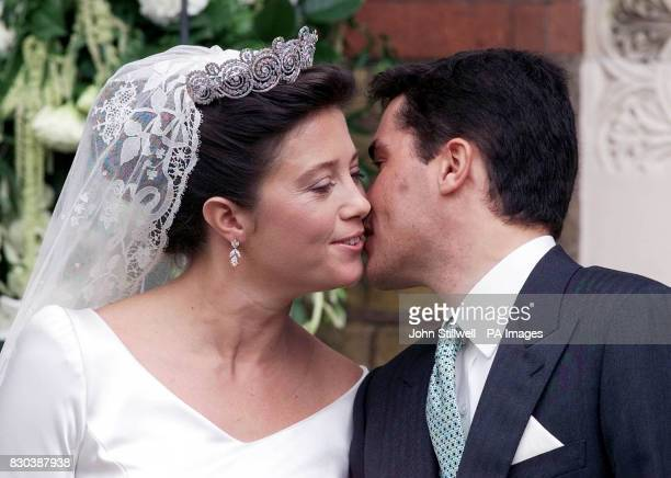 Princess Alexia of Greece gets a kiss from her husband Carlos Morales Quintana after their wedding at the Greek Orthodox Church in London * The...