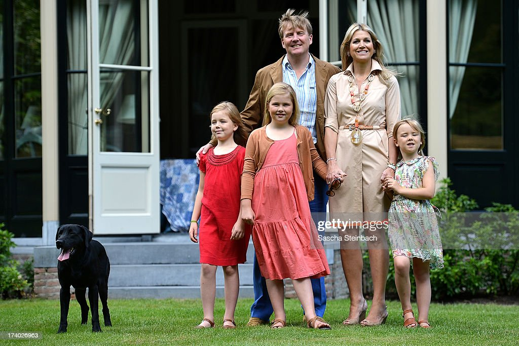 Princess Alexia of the Netherlands, Crown Princess Catharina-Amalia of the Netherlands, King Willem-Alexander of the Netherlands, Queen Maxima of the Netherlands and Princess Ariane of the Netherlands pose with their dog 'Skipper' during the annual summer photocall at Horsten Estate on July 19, 2013 in Wassenaar, Netherlands.