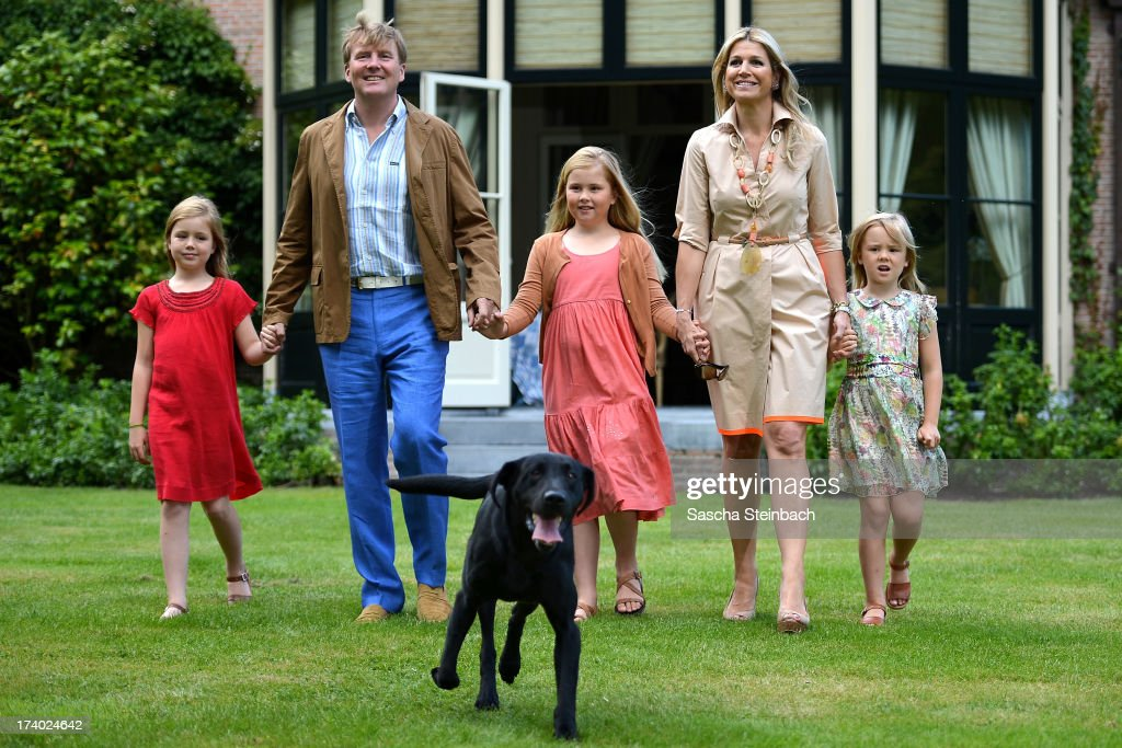 Princess Alexia of the Netherlands, King Willem-Alexander of the Netherlands, Crown Princess Catharina-Amalia of the Netherlands, Queen Maxima of the Netherlands and Princess Ariane of the Netherlands pose with their dog 'Skipper' during the annual summer photocall at Horsten Estate on July 19, 2013 in Wassenaar, Netherlands.