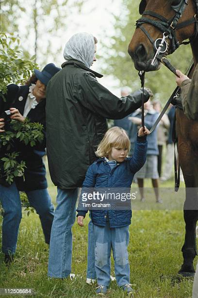Princess Anne and her daughter Zara Phillips holding the reins of a horse at the Royal Windsor Horse Show held at Home Park in Windsor Berkshire...