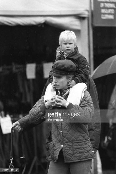 Princess Anne carries her daughter Zara on her shoulders at the Burghley Horse Trials in Stamford