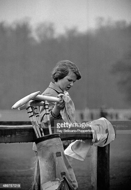 Princess Anne cleaning her father's polo gear at Smith's Lawn in Windsor Great Park on 23rd April 1962