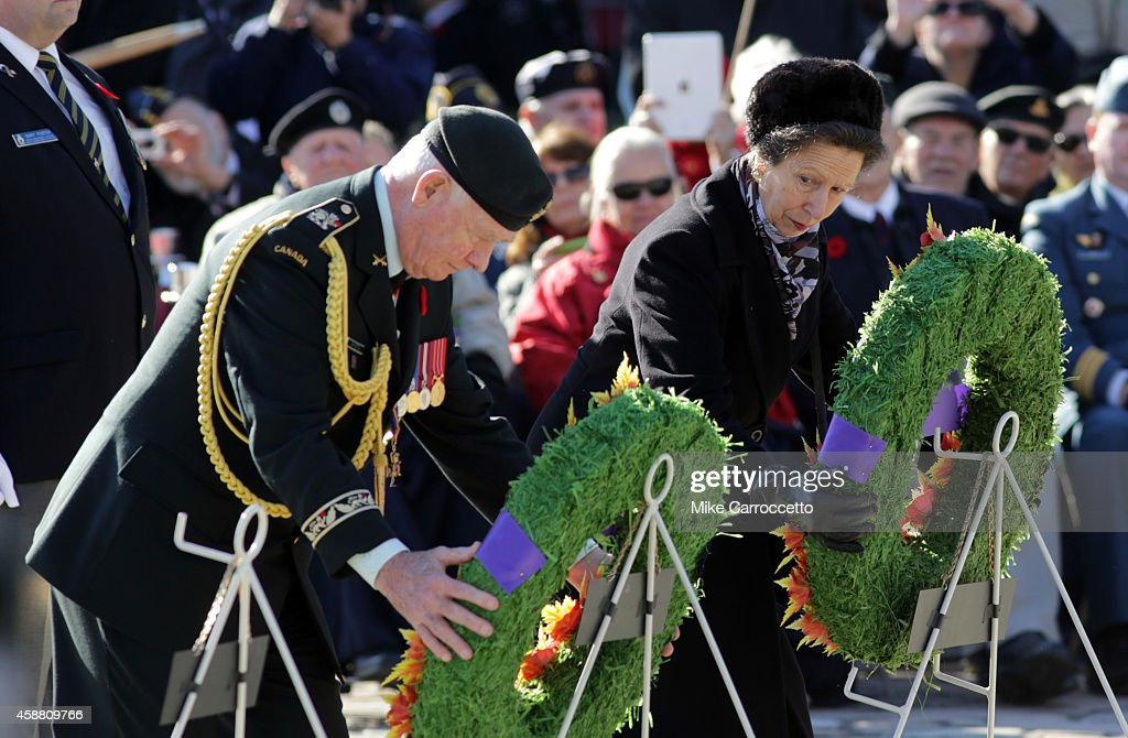 <a gi-track='captionPersonalityLinkClicked' href=/galleries/search?phrase=Princess+Anne+-+Princess+Royal&family=editorial&specificpeople=11706204 ng-click='$event.stopPropagation()'>Princess Anne</a> (Queen Elizabeth's daughter) glances over at Governor General <a gi-track='captionPersonalityLinkClicked' href=/galleries/search?phrase=David+Johnston+-+Politician&family=editorial&specificpeople=7915223 ng-click='$event.stopPropagation()'>David Johnston</a> (left)as they each lay a wreath during this morning's Remembrance Day ceremony, November 11, 2014 in Ottawa, Canada. An estimated 50,000 or more people lined the streets around the War Memorial Monument to take in the ceremony.