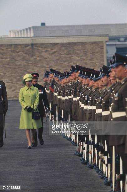 Princess Anne inspects a line of British Army soldiers on the parade ground during a presentation of the new colours to the first Battalion...