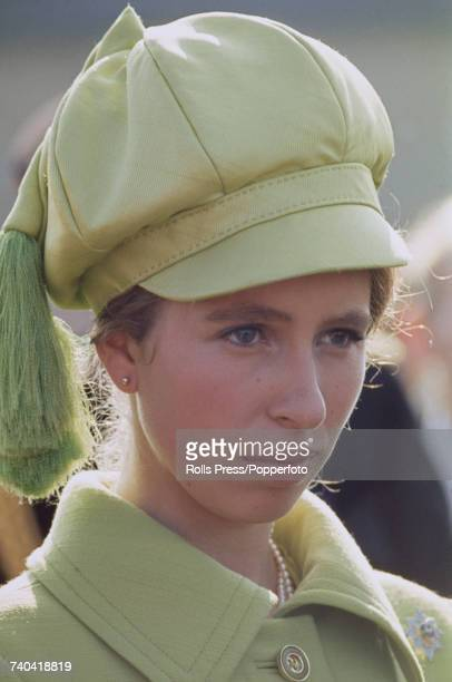 Princess Anne pictured wearing an olive green coat with matching peaked cap and tassle as she inspects a line of troops on the parade ground during a...