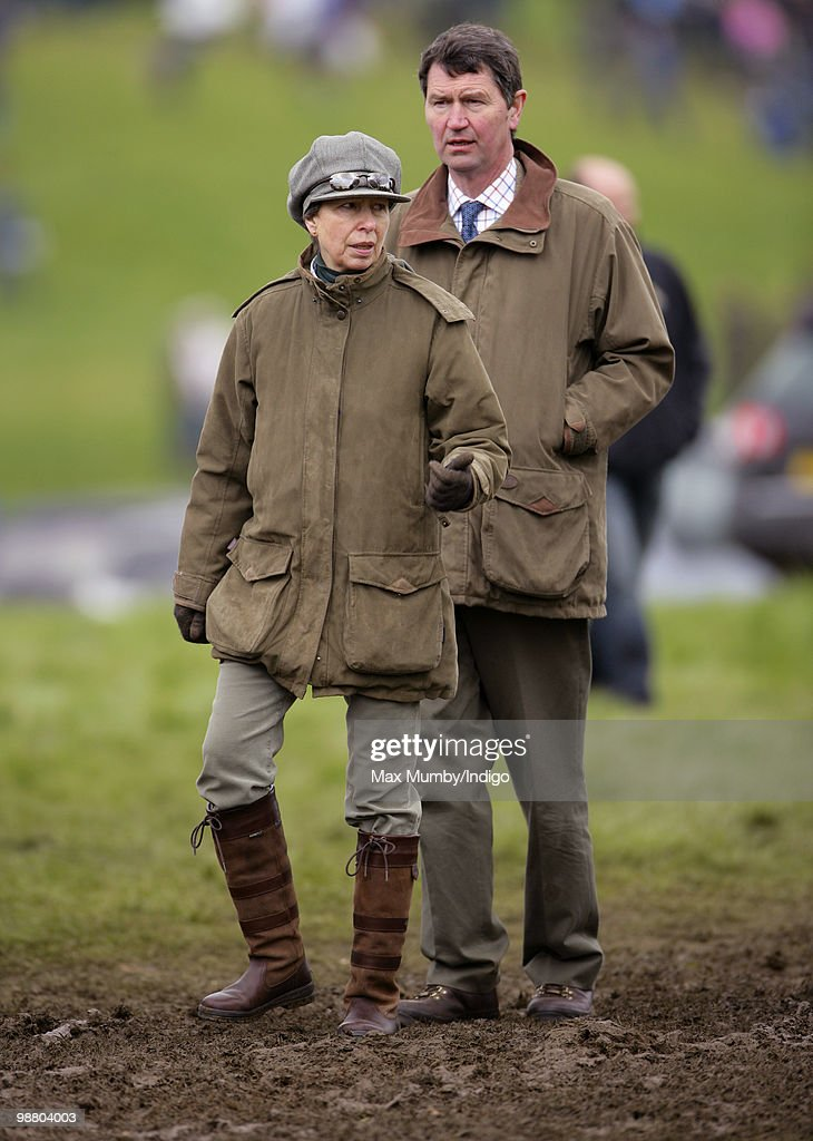 <a gi-track='captionPersonalityLinkClicked' href=/galleries/search?phrase=Princess+Anne+-+Princess+Royal&family=editorial&specificpeople=11706204 ng-click='$event.stopPropagation()'>Princess Anne</a>, Princess Royal and husband Vice-Admiral Tim (Timothy) Laurence stand in a muddy field as they attend the Badminton Horse Trials, in which <a gi-track='captionPersonalityLinkClicked' href=/galleries/search?phrase=Princess+Anne+-+Princess+Royal&family=editorial&specificpeople=11706204 ng-click='$event.stopPropagation()'>Princess Anne</a>'s daughter Zara Phillips is competing on May 2, 2010 in Badminton, Gloucestershire.