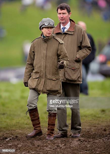 Princess Anne Princess Royal and husband ViceAdmiral Tim Laurence stand in a muddy field as they attend the Badminton Horse Trials in which Princess...