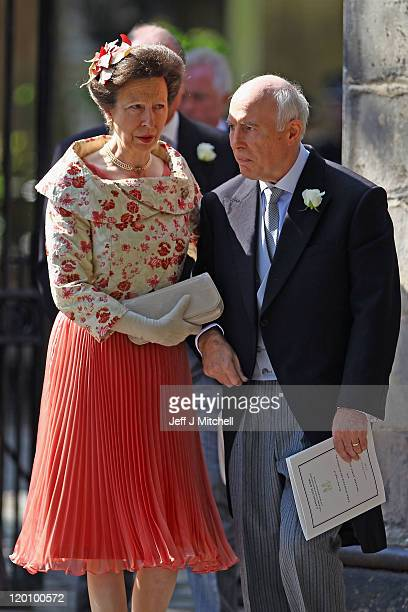 Princess Anne Princess Royal and Phil Tindall depart from the Royal wedding of Zara Phillips and Mike Tindall at Canongate Kirk on July 30 2011 in...