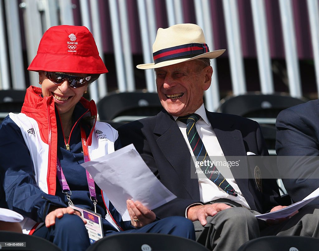 Princess Anne, Princess Royal and Prince Philip, Duke of Edinburgh smile on Day 2 of the London 2012 Olympic Games at Greenwich Park on July 29, 2012 in London, England.