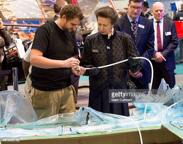 Princess Anne Princess Royal helps to build a boat by injecting resin into a frame during a visit to the London Boat Show at ExCel on January 14 2015...