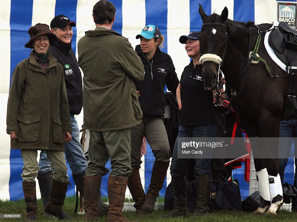 Princess Anne, Princess Royal (L) jokes with some of the grooms as they help prepare the horses for the show jumping during the Badminton Horse Trials on May 4 2008 in Badminton, England. Reigning world champion Zara Phillips rode Glenbuck and Ardfield Magic Star at the event - as the British equestrian team look to finalise their 2008 Olympics squad. The event started with two days of dressage then went into cross country before finishing with the jumping test today.