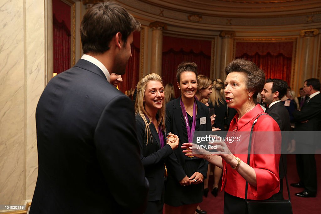 Princess Anne, Princess Royal meets cyclists <a gi-track='captionPersonalityLinkClicked' href=/galleries/search?phrase=Laura+Trott+-+Cyclist&family=editorial&specificpeople=7205074 ng-click='$event.stopPropagation()'>Laura Trott</a> and Danielle King during a reception for the Team GB Olympic and Paralympic medalists at Buckingham Palace on October 23, 2012 in London, England.