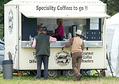 Princess Anne Princess Royal queues at a coffee stand as she attends the Whatley Manor International Horse Trials at Gatcombe Park Minchinhampton on...