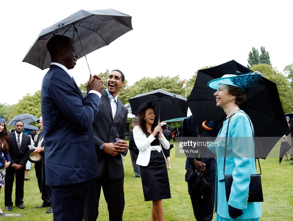 Princess Anne, Princess Royal speaks to members of the Team GB Olympic Basketball Team, including Kieron Achara (2nd L) during a garden party held at Buckingham Palace, on May 30, 2013 in London, England.