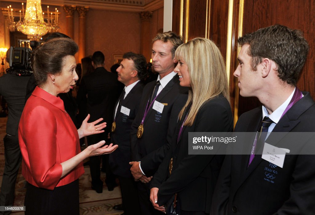 Princess Anne, Princess Royal (L) talks to (L-R) <a gi-track='captionPersonalityLinkClicked' href=/galleries/search?phrase=Carl+Hester&family=editorial&specificpeople=2298469 ng-click='$event.stopPropagation()'>Carl Hester</a>, <a gi-track='captionPersonalityLinkClicked' href=/galleries/search?phrase=Charlotte+Dujardin&family=editorial&specificpeople=5426239 ng-click='$event.stopPropagation()'>Charlotte Dujardin</a> and <a gi-track='captionPersonalityLinkClicked' href=/galleries/search?phrase=Scott+Brash&family=editorial&specificpeople=7104508 ng-click='$event.stopPropagation()'>Scott Brash</a> during a reception held for Team GB Olympic and Paralympic London 2012 medalists at Buckingham Palace on October 23, 2012 in London, England.
