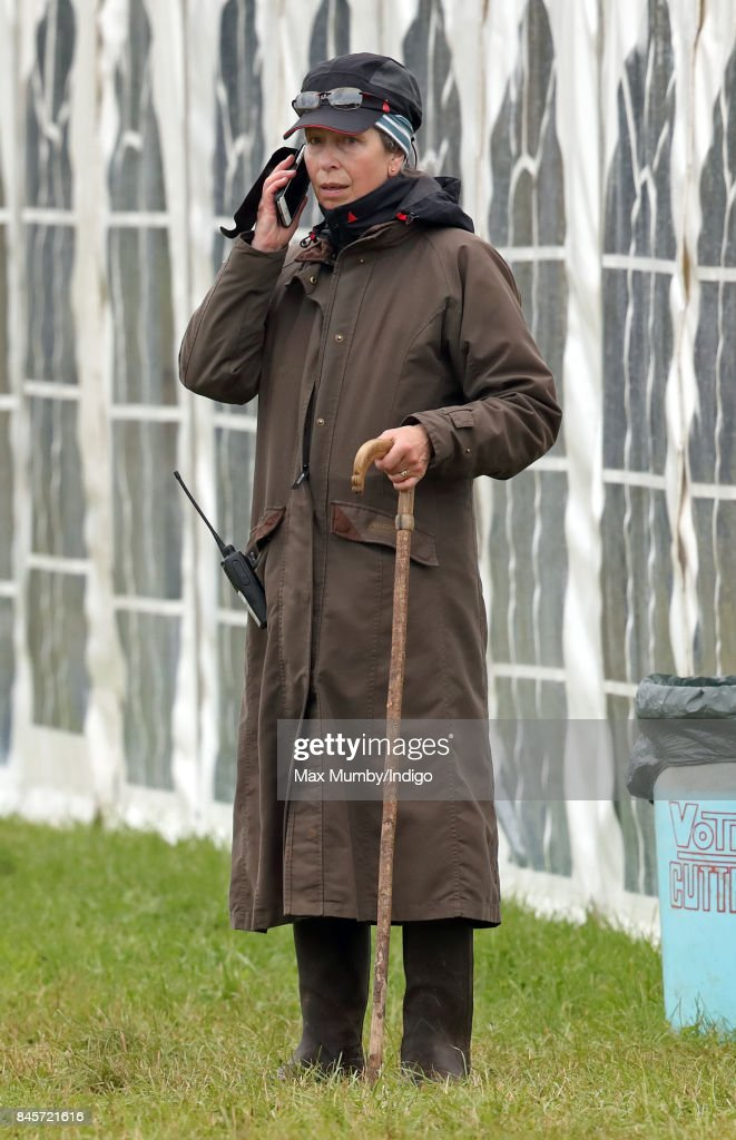 Princess Anne, Princess Royal uses her mobile phone as she attends day 3 of the Whatley Manor Horse Trials at Gatcombe Park on September 10, 2017 in Stroud, England.