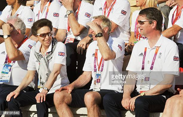 Princess Anne Princess Royal with former Olympian David Hemery and her husband Vice Admiral Sir Tim Laurence share a laugh as Team GB arrive in the...