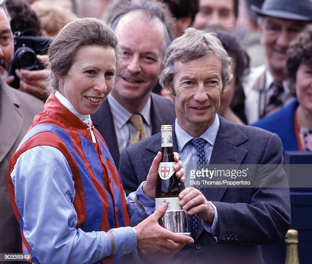 HRH Princess Anne receives a commemorative trophy from Lester Piggott after making her flat racing debut at the Farriers Invitation Private...