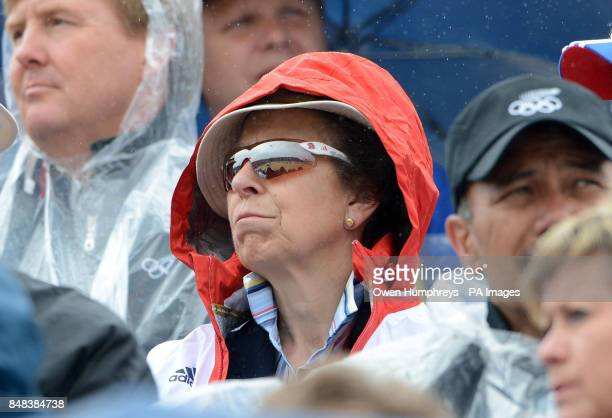 Princess Anne shelters from the rain as she watches the Individual Eventing Jumping Final on day four of the London Olympic Games at Greenwich Park...