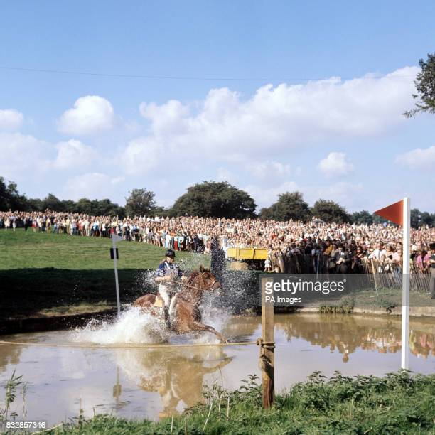 Princess Anne splashing through the 'trout hatchery' on Doublet as she competed in the cross country event of the European threeday event...
