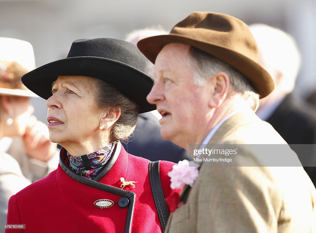 Princess Anne, The Princess Royal and Andrew Parker Bowles watch the racing as they attend Day 4 of the Cheltenham Festival at Cheltenham Racecourse on March 14, 2014 in Cheltenham, England.