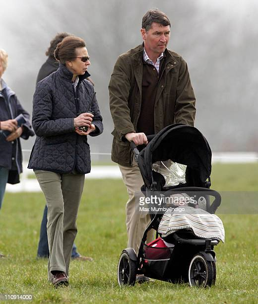 Princess Anne The Princess Royal and husband ViceAdmiral Tim Laurence push granddaughter Savannah Phillips in her pushchair at the Gatcombe Park...
