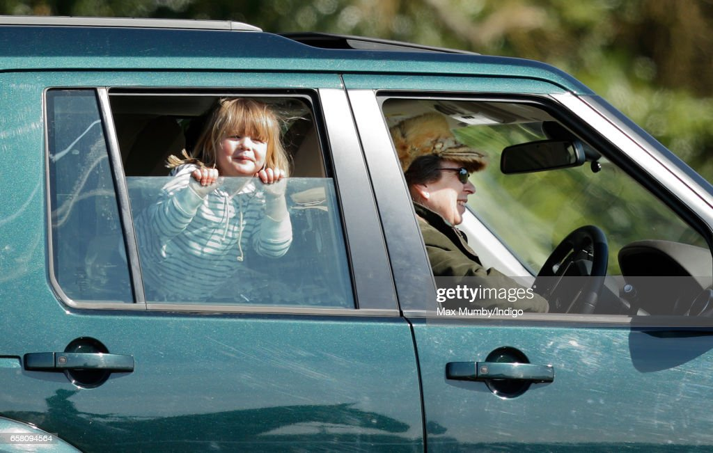 Princess Anne, The Princess Royal drives granddaughter Mia Tindall around the Gatcombe Horse Trials at Gatcombe Park on March 26, 2017 in Stroud, England.