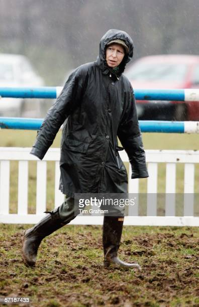 Princess Anne the Princess Royal in Barbour style raincoat and wellington boots trudges through thick mud at the British Eventing Gatcombe Horse...