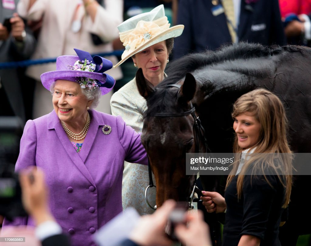 Princess Anne, The Princess Royal looks on as Queen <a gi-track='captionPersonalityLinkClicked' href=/galleries/search?phrase=Elizabeth+II&family=editorial&specificpeople=67226 ng-click='$event.stopPropagation()'>Elizabeth II</a> pats her Gold Cup winning horse Estimate on Ladies Day of Royal Ascot at Ascot Racecourse on June 20, 2013 in Ascot, England.