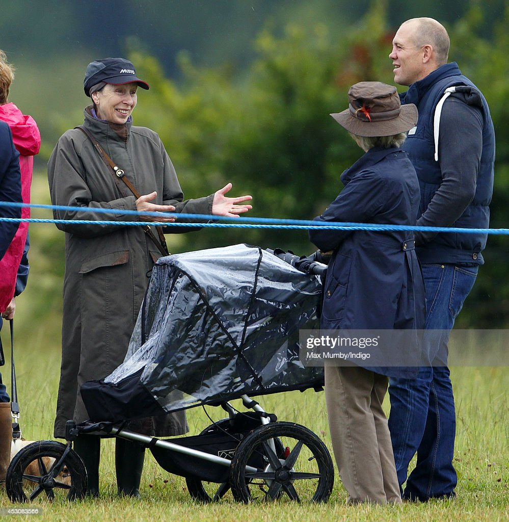 <a gi-track='captionPersonalityLinkClicked' href=/galleries/search?phrase=Princess+Anne+-+Princess+Royal&family=editorial&specificpeople=11706204 ng-click='$event.stopPropagation()'>Princess Anne</a>, The Princess Royal talks with <a gi-track='captionPersonalityLinkClicked' href=/galleries/search?phrase=Mike+Tindall&family=editorial&specificpeople=204210 ng-click='$event.stopPropagation()'>Mike Tindall</a> (pushing daughter Mia Tindall in her buggy) as they watch Zara Phillips compete on her horse High Kingdom in the dressage phase of the Festival of British Eventing at Gatcombe Park on August 2, 2014 in Minchinhampton, England.