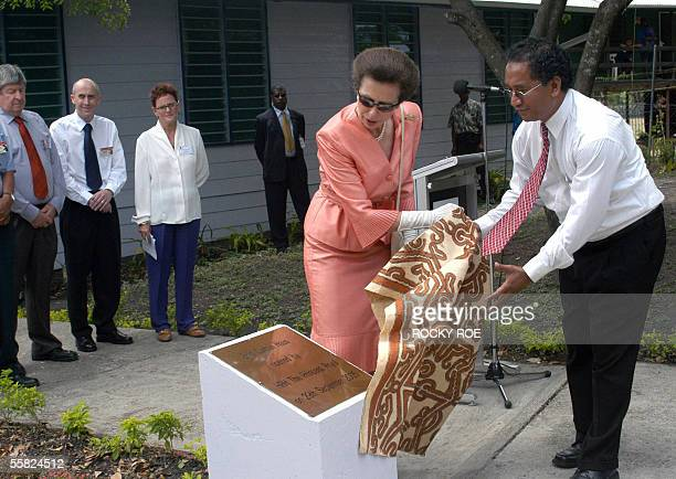Princess Anne unveils a plague with the help of Stephen Kassman chairman of Cheshire Homes as she opens the hostel 'Enid Curtain Haus' in Port...