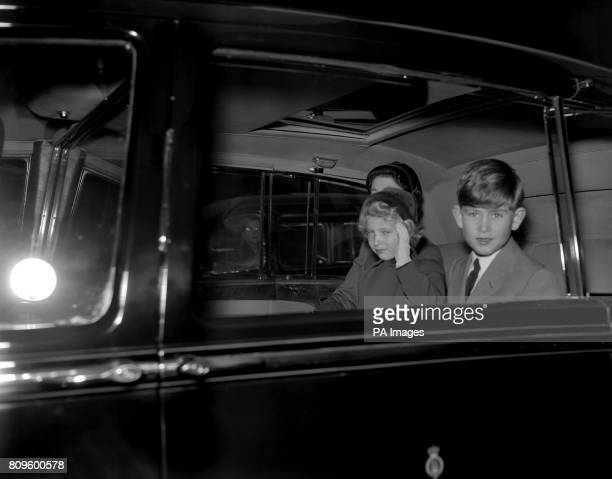 Princess Anne waves as she drives with her brother Prince Charles from Euston Station to Buckingham Palace They were returning with the Queen from a...