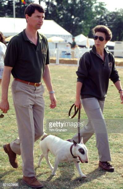 Princess Anne With Her Husband Tim Laurence And Her Pet Bull Terrier Bitch Eglantine Walking Together At Gatcombe Park Horse Trials In Gloucestershire