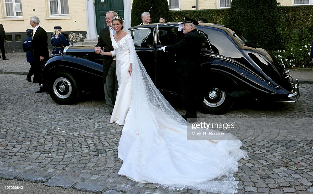 Princess Annemarie Gualtherie van Weezel and Prince Carlos de Bourbon de Parme pose for a photo in front of their car after their Roayl Wedding at Abbaye de la Cambre on November 20, 2010 in Brussels, Belgium.