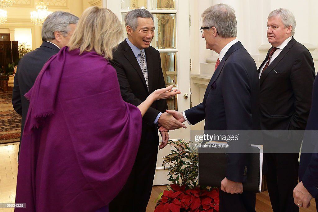 Princess Astrid Of Belgium (L) introduces Minister-President of Flanders, Geert Bourgeois (3L) to Prime Minister of Singapore, Lee Hsien Loong (2L) as Vice-President and Minister of Economy for Wallonia, Jean-Claude Marcourt looks on at the Istana on November 27, 2014 in Singapore. Princess Astrid Of Belgium is in Singapore for a three days official visit to promote economic and research development between the two countries.