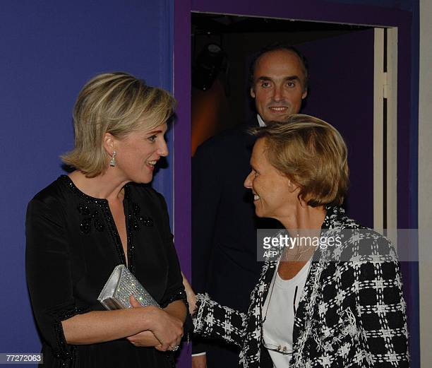 Princess Astrid of Belgium listens to French journalist Christine Ockrent as Prince Lorenz looks on prior a gala dinner on the first day of the...