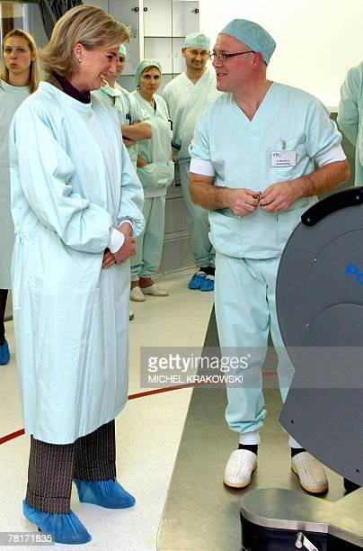 Princess Astrid of Belgium listens to Professor Didier Martin during a visit at the CHU hospital in Liege 30 November 2007 as part of the hospital's...